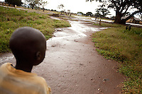 Isaac, age 8, a patient walks home after a visit to MSF's HIV treatment program in Madi Opei, Uganda.