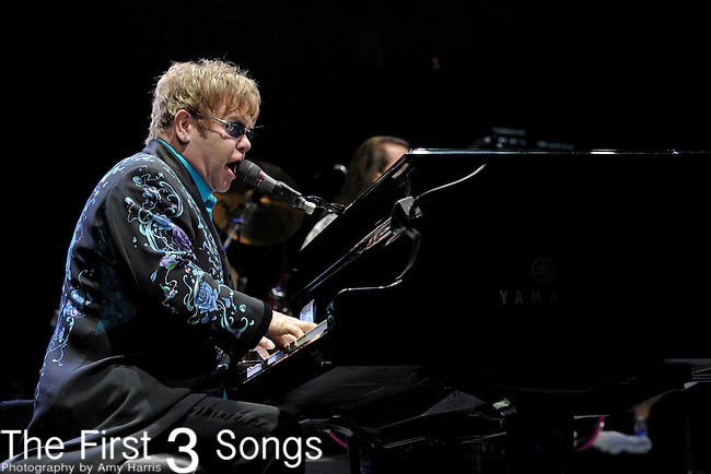 Elton John performs during his Greatest Hits Live Tour at the KFC Yum! Center in Louisville, KY on April 15, 2011.