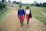 NGUDWINI, SOUTH AFRICA - SEPTEMBER 10: Nobule Ngema, age 16, (L) walks with a friend to her high school on September 10, 2004 in Ngudwini village in rural Natal, South Africa. She's preparing to travel to the annual Reed Dance where about 20.000 fellow maidens from all over South Africa gathers to dance for the Zulu King. The girls come to the kingdom to declare their virginity and the ceremony encourages girls and young women to abstain from sexual activity to curb the spread of HIV-Aids. Its Nobuhle's first trip and she's already has three virginity certificates as she was tested in the village the last three years. .(Photo: Per-Anders Pettersson)......