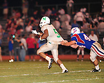 Newman running back Ronnie Vinson is slowed by an unidentified John Curtis defender during 34-7 loss to John Curtis.  Vinson has verbally committed to play football at LSU.