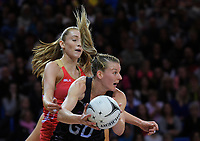Katrina Grant takes a pass under pressure from Helen Housby during the Taini Jamieson Trophy Series netball match between the New Zealand Silver Ferns and England Roses at Te Rauparaha Arena in Porirua, New Zealand on Wednesday, 7 September 2017. Photo: Dave Lintott / lintottphoto.co.nz