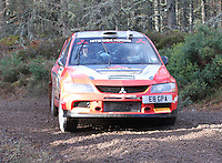 Brian Watson - Caroline Will in a Mitsubishi Lancer Evolution 8 competing at Junction 6 on the Munro Scotch Beef Millbuie Special Stage 1 on the 2014 Arnold Clark/Thistle Hotel Snowman Rally, supported by Highland Office Equipment, part of Capital Document Solutions which was organised by Highland Car Club and based in Inverness on 22.2.14; Round 1 of the 2014 RAC MSA Scottish Rally Championship sponsored by ARR Craib Transport Limited.