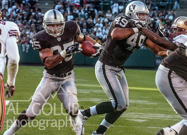 Oakland Raiders full back John Paul Foschi (49) blocks for running back Justin Fargas (25) on Sunday, August 20, 2006, in Oakland, California. The Raiders defeated the 49ers 23-7 in a preseason game.