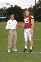 7 August 2006: Stanford Cardinal head coach Walt Harris and Chris Horn during Stanford Football's Team Photo Day at Stanford Football's Practice Field in Stanford, CA.