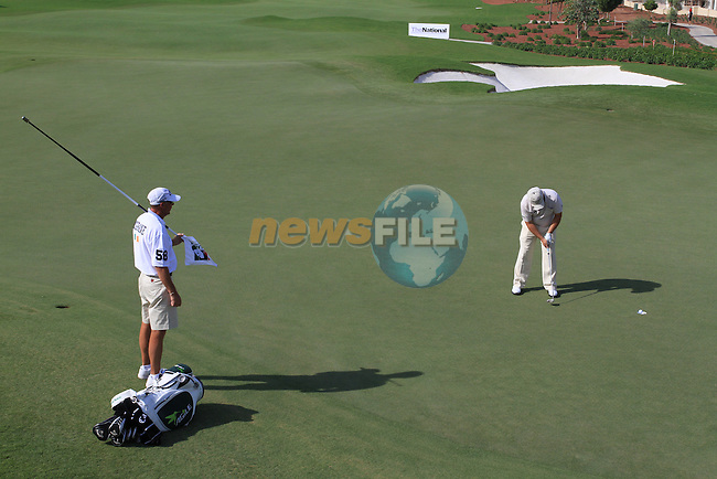 Damien McGrane putts out on the 9th green during  Day 2 at the Dubai World Championship Golf in Jumeirah, Earth Course, Golf Estates, Dubai  UAE, 20th November 2009 (Photo by Eoin Clarke/GOLFFILE)