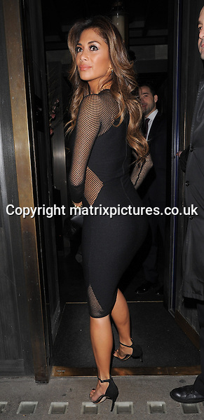NON EXCLUSIVE PICTURE: PALACE LEE / MATRIXPICTURES.CO.UK<br /> PLEASE CREDIT ALL USES<br /> <br /> WORLD RIGHTS<br /> <br /> American singer Nicole Scherzinger is pictured arriving at Hakkasan Restaurant in London's West End.<br /> <br /> Nicole looks happy and sexy in her tight black dress as rumours circulate that she may have recently become engaged to Formula One star Lewis Hammilton.<br /> <br /> MARCH 17th 2014<br /> <br /> REF: LTN 141360