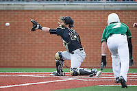 Wake Forest Demon Deacons catcher Logan Harvey (15) reaches for the baseball as Reece Hampton (2) of the Charlotte 49ers begins his slide into home plate at Hayes Stadium on March 16, 2016 in Charlotte, North Carolina.  The 49ers defeated the Demon Deacons 7-6.  (Brian Westerholt/Four Seam Images)