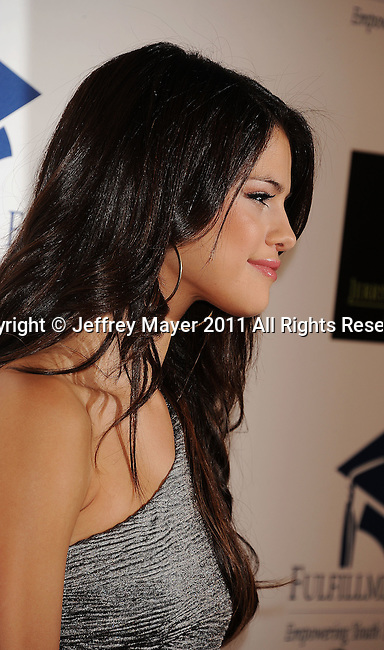 "BEVERLY HILLS, CA - NOVEMBER 01: Selena Gomez arrives at The Fulfillment Fund's ""2011 Stars Gala"" held at The Beverly Hilton Hotel on November 1, 2011 in Beverly Hills, California."