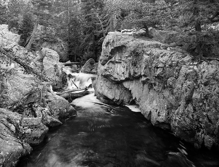 """A set of cascades formed by the confluence of Fern Creek and the Big Thompson River creates """"The Pool.""""  Here, the water has carved out a channel through the rock and formed a pool of deep cold water.  The trail continues on up past Fern Falls and Fern Lake."""