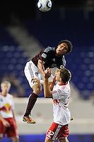 Quincy Amarikwa (12) of the Colorado Rapids gets out of shape going up for a header. The New York Red Bulls defeated the Colorado Rapids 3-0 during a U. S. Open qualifier match at Red Bull Arena in Harrison, NJ, on May 26, 2010.
