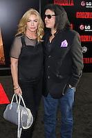 "HOLLYWOOD, LOS ANGELES, CA, USA - MAY 08: Shannon Tweed Simmons, Gene Simmons at the Los Angeles Premiere Of Warner Bros. Pictures And Legendary Pictures' ""Godzilla"" held at Dolby Theatre on May 8, 2014 in Hollywood, Los Angeles, California, United States. (Photo by Xavier Collin/Celebrity Monitor)"