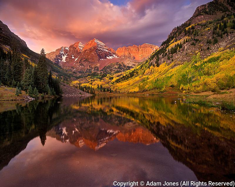 Maroon Bells reflected on Maroon Lake at sunrise, Colorado