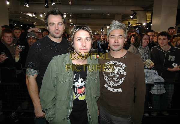FEEDER.GRANT NICOLAS (CENTRE).At record signing, HMV Oxford Street, London, .February 1st 2005..half length mickey mouse t-shirt.Ref: HT.www.capitalpictures.com.sales@capitalpictures.com.©Capital Pictures.