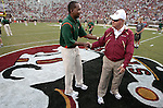 Miami Coach Randy Shannon (L) and Florida State coach Bobby Bowden shake hands prior the first half of the University of Miami Hurricane's 38-34 defeat of the Florida State Seminoles in Tallahassee September 7, 2009.  (Mark Wallheiser/TallahasseeStock.com)