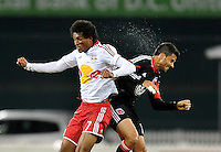 D.C. United midfielder Marcelo Saragosa (11) goes against New York Red Bulls defender Roy Miller (7)  The New York Red Bulls tied D.C. United 1-1 in the first leg of the Eastern Conference semifinals at RFK Stadium, Saturday November 3, 2012.