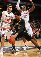 Wake Forest forward Devin Thomas (2) is defended by Virginia forward/center Mike Tobey (10) and Virginia forward Akil Mitchell (25) during the first half of an NCAA basketball game Wednesday Jan. 08, 2014 in Charlottesville, VA. (Photo/The Daily Progress/Andrew Shurtleff)