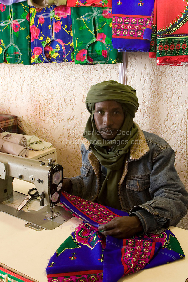 Tripoli, Libya - Ali, Libyan Tuareg Tailor, Tripoli Medina.  His traditional male Tuareg veil (tagulmust) and Western-style denim jacket are a synthesis of modern and traditional attire.