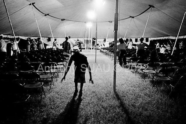 New Orleans, Louisiana.USA.July 28, 2006..A traveling church revival in the 7th ward, a district hit hard by the flooding nearly one year after hurricane Katrina struck and the levees broke leaving 80% of the city under water...