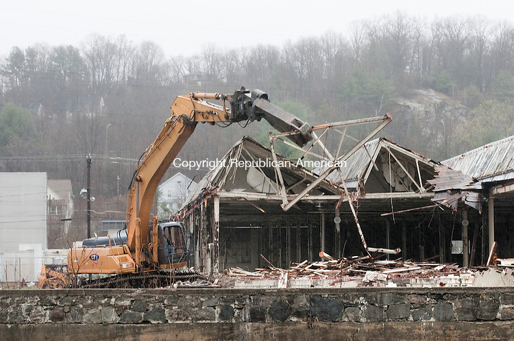 TORRINGTON, CT, 21 APRIL 15 - A steel roof truss is removed from the Nidec building on Franklin Drive in Torrington as workers began to raze the former factory Tuesday morning.     Alec Johnson/ Republican-American