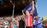 Lincoln City's Harry Anderson celebrates after winning the league<br /> <br /> Photographer Chris Vaughan/CameraSport<br /> <br /> The EFL Sky Bet League Two - Lincoln City v Tranmere Rovers - Monday 22nd April 2019 - Sincil Bank - Lincoln<br /> <br /> World Copyright © 2019 CameraSport. All rights reserved. 43 Linden Ave. Countesthorpe. Leicester. England. LE8 5PG - Tel: +44 (0) 116 277 4147 - admin@camerasport.com - www.camerasport.com