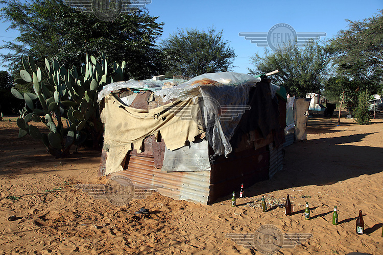 A shanty house made from corrugated iron, tarpaulin and plastic sheeting.