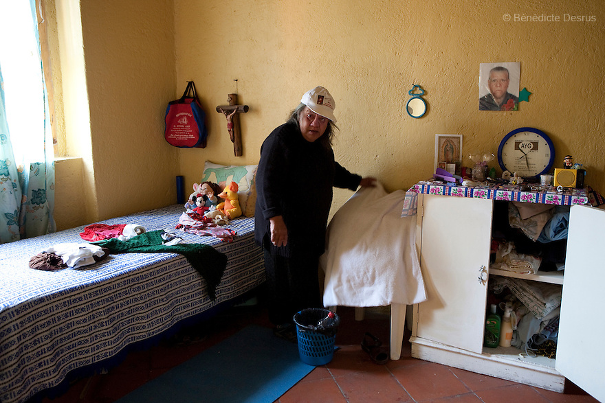 Canela, a resident of Casa Xochiquetzal, in her bedroom at the shelter in Mexico City, Mexico on November 24, 2008. Casa Xochiquetzal is a shelter for elderly sex workers in Mexico City. It gives the women refuge, food, health services, a space to learn about their human rights and courses to help them rediscover their self-confidence and deal with traumatic aspects of their lives. Casa Xochiquetzal provides a space to age with dignity for a group of vulnerable women who are often invisible to society at large. It is the only such shelter existing in Latin America. Photo by Bénédicte Desrus