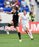 Lauren Cheney (12) of the USWNT takes a touch on the ball in front of Natalie Vinti (5) of Mexico during the game at Red Bull Arena in Harrison, NJ.  The USWNT defeated Mexico, 1-0.
