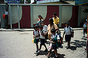 School children leave school after the break in Colombo, Sri Lanka.  Photo: Sanjit Das/Panos