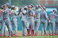 Josh McLain (15) of the North Carolina State Wolfpack high fives his teammates following the win over the Northeastern Huskies at Doak Field at Dail Park on June 2, 2018 in Raleigh, North Carolina. The Wolfpack defeated the Huskies 9-2. (Brian Westerholt/Four Seam Images)
