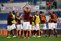 Calcio, Serie A: Roma vs Lazio. Roma, stadio Olimpico, 8 novembre 2015.<br /> Roma's Edin Dzeko, foreground, and his teammates celebrate at the end of the Italian Serie A football match between Roma and Lazio at Rome's Olympic stadium, 8 November 2015. Roma won 2-0.<br /> UPDATE IMAGES PRESS/Isabella Bonotto