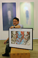 Steven Lam  poses with his work in his studio Hong Kong, 19th July 2010. The Wah Luen Industrial Building in Fotan, Hong Kong, home to a community of Hong Kong artsists that have converted the industrial space into studios. <br /> <br /> photo by Richard Jones/Sinopix