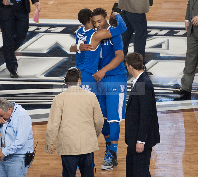 Kentucky Wildcats guard Andrew Harrison (5) and forward James Young (1) hug after winning the NCAA Final Four vs. Wisconsin at the AT&T in Arlington, Tx., on Saturday, April 5, 2014. Photo by Eleanor Hasken | Staff