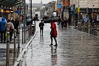2020 02 14 Shoppers walk in the rain in Oxford Street, Swansea, Wales, UK
