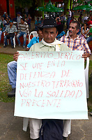 """PALERMO COLOMBIA - APRIL 29: A farmer holds a poster as he attends the """"frutos de mi Tierra"""" forum on April 29, 2017 in Palermo, Antioquia. The Anti mining forum it's taking place in the town as environmental concerns arise in reaction of the threat from South African miner AngloGold Ashanti plans to develop a open-pit gold mines in the central Colombian region.  Photo by VIEWpress/Guillermo Betancur"""