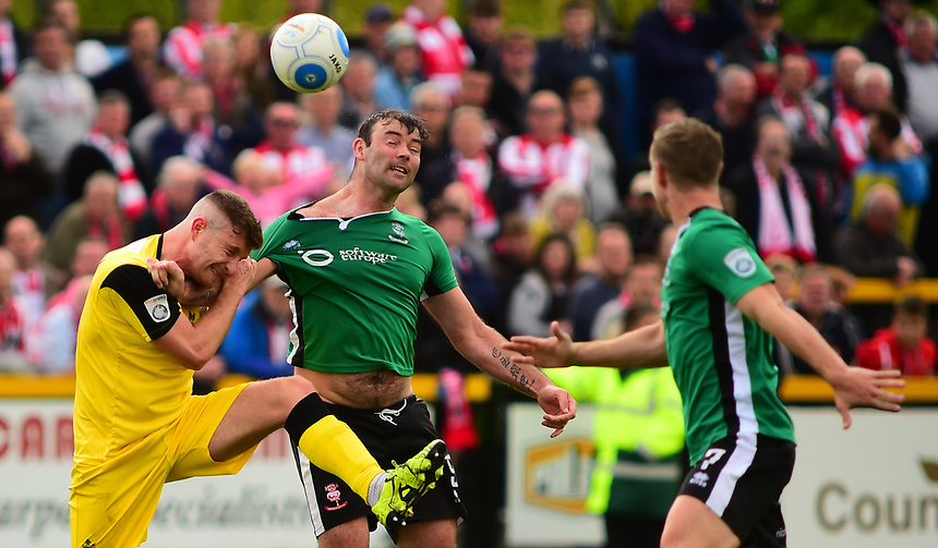 Lincoln City's Matt Rhead vies for possession with Southport's Euan Murray<br /> <br /> Photographer Andrew Vaughan/CameraSport<br /> <br /> Vanarama National League - Southport v Lincoln City - Saturday 29th April 2017 - Merseyrail Community Stadium - Southport<br /> <br /> World Copyright &copy; 2017 CameraSport. All rights reserved. 43 Linden Ave. Countesthorpe. Leicester. England. LE8 5PG - Tel: +44 (0) 116 277 4147 - admin@camerasport.com - www.camerasport.com