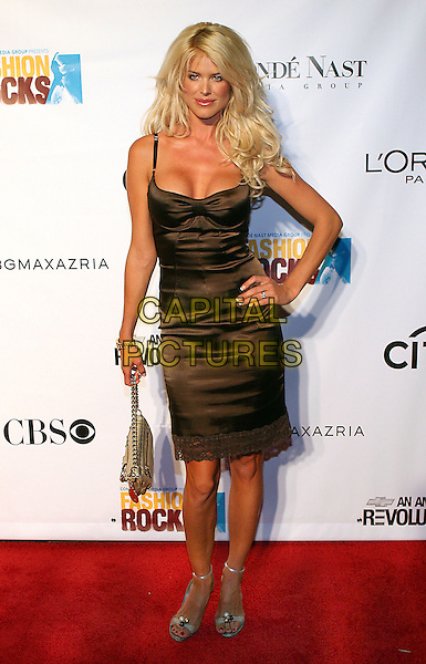 VICTORIA SILVSTEDT.At Fashion Rocks held at Radio City Music Hall,.New Tork, 8th September 2005.full length brown satin strappy dress cleavage hand hip engagement ring .Ref: ADM/JL.www.capitalpictures.com.sales@capitalpictures.com.© Capital Pictures.