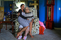 "Shannon Wells sits on laps of her Mom, as they pose for a photograph. 87 years old Billie Wells instructs to her daughter Shannon Wells to this pose for a photograph and says, ""Daughter never grows too old to be held by her Mother"". Shannon Wells working as a University Photographer since1990 to present."