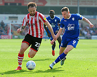 Lincoln City's Neal Eardley under pressure from Tranmere Rovers' Paul Mullin<br /> <br /> Photographer Andrew Vaughan/CameraSport<br /> <br /> The EFL Sky Bet League Two - Lincoln City v Tranmere Rovers - Monday 22nd April 2019 - Sincil Bank - Lincoln<br /> <br /> World Copyright © 2019 CameraSport. All rights reserved. 43 Linden Ave. Countesthorpe. Leicester. England. LE8 5PG - Tel: +44 (0) 116 277 4147 - admin@camerasport.com - www.camerasport.com