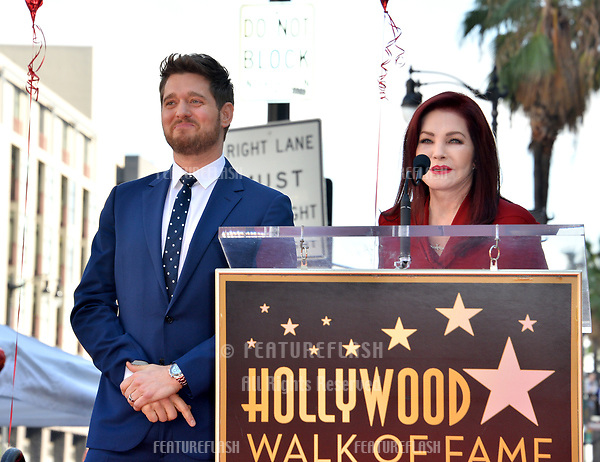 LOS ANGELES, CA. November 16, 2018: Michael Buble & Priscilla Presley at the Hollywood Walk of Fame Star Ceremony honoring singer Michael Bublé.<br /> Pictures: Paul Smith/Featureflash