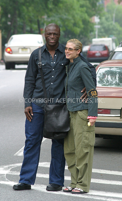 British rocker Seal and his model girlfriend Heidi Klum can hardly contain their amusement at the sight of our photographer as they hail a cab near Klum's  West Village apartment. New York City. May 26 2004. Please byline: BRIAN FLANNERY/ ACE Pictures.   ..*PAY-PER-USE*      ....IMPORTANT: Please note that our old trade name, NEW YORK PHOTO PRESS (NYPP), is replaced by our new name, ACE PICTURES. New York Photo Press and ACE Pictures are owned by All Celebrity Entertainment, Inc.......All Celebrity Entertainment, Inc:  ..contact: Alecsey Boldeskul (646) 267-6913 ..Philip Vaughan (646) 769-0430..e-mail: info@nyphotopress.com