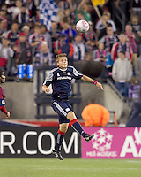 New England Revolution defender Seth Sinovic (27) heads the ball. Real Salt Lake defeated the New England Revolution, 2-1, at Gillette Stadium on October 2, 2010.