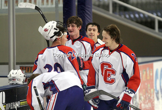 Cherry Creek's Joshua Yovich (No. 20), Michael King (12),   Michael Dubus (6) and Nicholas Lardner (14). Cherry Creek (Colorado) beat Medina (Ohio) 5-1 on the third day of pool play during the 2014 High School Hockey National Championship in Omaha on March 28. (Photo by Michelle Bishop)