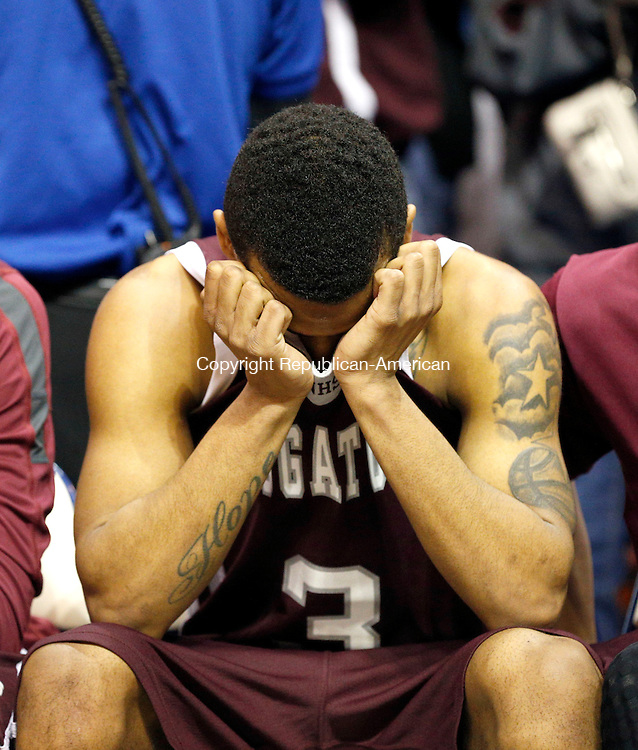 Uncasville, CT- 22 March 2015-032215CM16- Naugatuck's Charles Wall covers his face after Naugatuck loses to Bunnell 72-61 at the Class L state championship game at Mohegan Sun Arena in Uncasville on Sunday.    Christopher Massa Republican-American