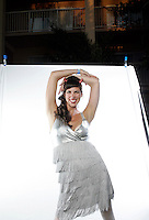 "SAN DIEGO,CA - AUGUST 14,2009: Tiki Oasis 9 Attendee Maggie, "" the Glamazon"", one of the the DEVIL-ETTES, a San Francisco based synchronized Go-Go dance Troupe. part of the good clean fun at Tiki Oasis 9, the largest west coast gathering of Tiki aficianados. Photographed for the IMAGE photo booth as they descended on San Diego for their annual weekend convention August 14, 2009."