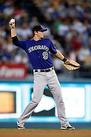 D.J. LeMahieu #9 of the Colorado Rockies in the field during a game against the Los Angeles Dodgers at Dodger Stadium on September 29, 2012 in Los Angeles, California. Los Angeles defeated Colorado 3-0. (Larry Goren/Four Seam Images)