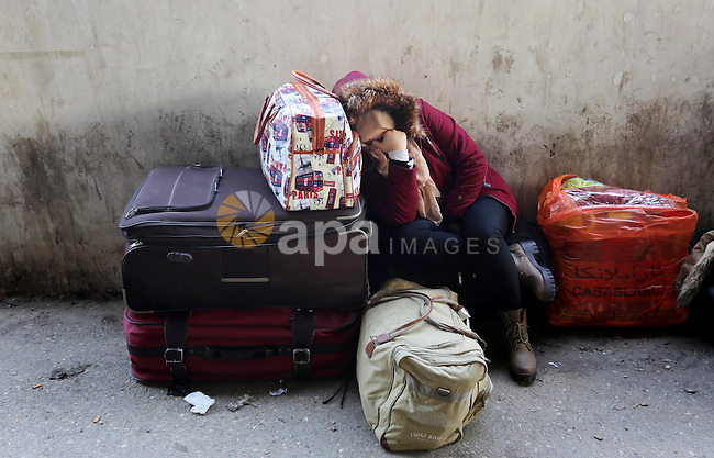 A Palestinian woman waits for travel permits to cross into Egypt through the Rafah border crossing after it was opened by Egyptian authorities for humanitarian cases, in Rafah in the southern Gaza Strip on February 11, 2017. Photo by Ashraf Amra