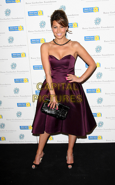 RACHEL STEVENS .Raisa Gorbachev Foundation Gala Dinner at Stud House, Hampton Court, London, England, UK, June 6th 2009..full length strapless purple dress hand on hip peep toe shoes clutch bag black .CAP/ROS.©Steve Ross/Capital Pictures