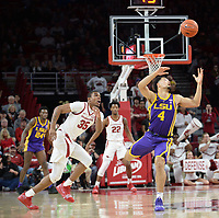 NWA Democrat-Gazette/ANDY SHUPE<br /> Arkansas forward Reggie Chaney (35) and LSU guard Skylar Mays (4) track down a loose ball Friday, Jan. 11, 2019, during the first half of play in Bud Walton Arena in Fayetteville. Visit nwadg.com/photos to see more photographs from the game.