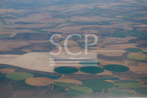 Central Brazil. Aerial view of huge circles of irrigated agricultural land.