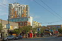 Businesses on Main Street and new residential buildings in the Mount Pleasant district of Vancouver, BC, Canada